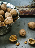 Organic walnuts from a garden in a metal bowl Stock Photo