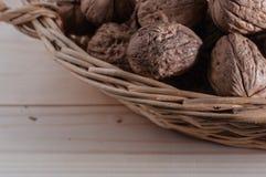 Organic walnuts. In a basket Stock Photo
