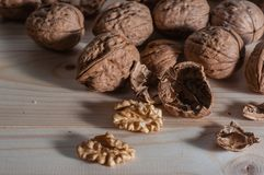 Organic walnuts. On a wood table Royalty Free Stock Photo