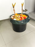 Organic waste in the black bucket. Separate garbage collection. Organic waste in the black bucket and plastic bag Royalty Free Stock Photos