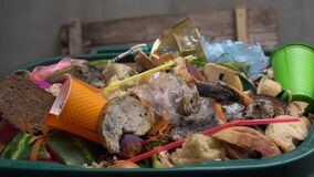 Organic waste, unsold food, uneaten bread, plastic in the trash can. The food throw out in household, home kitchen or in