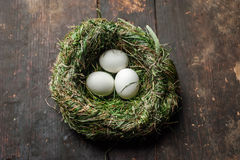 Organic white eggs in hay nest. Eco food. Organic white eggs in hay nest at wooden table. Eco food composition in rural vintage style stock photography