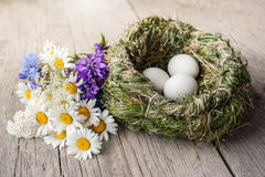 Organic white eggs and meadow flowers Stock Photography