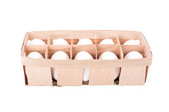 Organic white eggs in wooden basket Royalty Free Stock Image