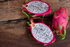 Organic white fresh dragon fruit cut into half on wooden chopping board. Copy space, salad, juicy, juice, berry, fruity, exotic, tropical, sweet, vegetable stock photography