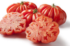 Organic whole and half Rebellion tomatoes Royalty Free Stock Images