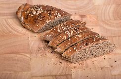 Organic wholemeal bread. Fresh, warm organic wholemeal bread, with seeds Royalty Free Stock Photos
