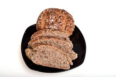 Organic wholemeal bread. Fresh, warm organic wholemeal bread, with seeds Royalty Free Stock Images