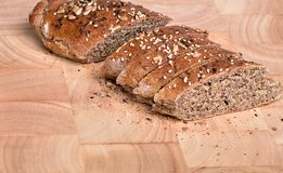 Organic wholemeal bread. Fresh, warm organic wholemeal bread, with seeds Stock Photo