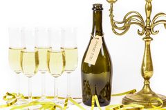 Organic wine / champagne. Glasses of champagne. Organic wine / champagne. Glasses of champagne, candelabra and party streamers. For new years eve celebration Stock Photo