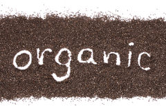 Organic word on chia seeds background isolated on white Stock Images