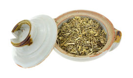 Organic wormwood in bowl with lid Royalty Free Stock Images