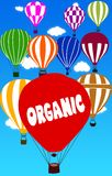 ORGANIC written on hot air balloon with a blue sky background. Illustration Royalty Free Stock Photos