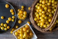 Organic yellow plums in a basket royalty free stock images