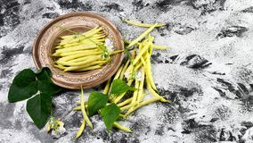 Organic yellow wax bean on an earthenware plate. top view copy space.  royalty free stock photo