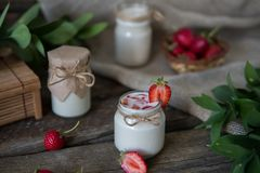 Organic yougurt in jar with strawberry. Fresh strawberry with yo. Gurt Royalty Free Stock Image