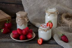 Organic yougurt in jar with strawberry. Fresh strawberry with yo Stock Photography