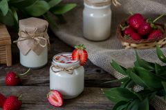 Organic yougurt in jar with strawberry. Fresh strawberry with yo. Gurt Royalty Free Stock Images