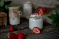 Organic yougurt in jar with strawberry. Fresh strawberry with yo royalty free stock images