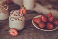 Organic yougurt in jar with strawberry. Fresh strawberry with yo Stock Photo