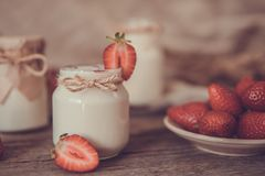 Organic yougurt in jar with strawberry. Fresh strawberry with yo. Gurt Stock Photo