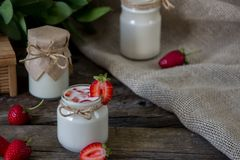 Organic yougurt in jar with strawberry. Fresh strawberry with yo. Gurt Royalty Free Stock Photo