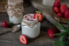 Organic yougurt in jar with strawberry. Fresh strawberry with yo. Gurt Stock Photography