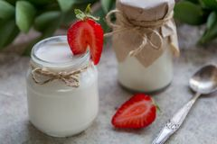 Organic yougurt in jar with strawberry. Fresh strawberry with yo. Gurt Royalty Free Stock Photos
