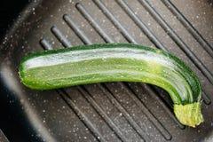 Organic zucchini in grill pan Royalty Free Stock Photo