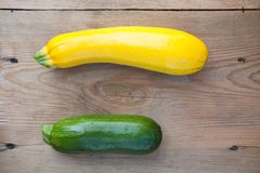 Organic  zucchini on wooden background, top view Royalty Free Stock Image