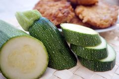 Fresh courgette or zucchini close up view, with fitters in the background. Organically prepared, natural fresh courgette or zucchini close up view, with fitters royalty free stock images