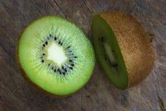 Organics Kiwi on wood board Stock Images