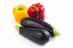Organics red, yellow Bell pepper and eggplants Stock Photos