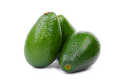 Organicznie Avocado na białym tle zdrowa żywność owoce tropikalne Trzy świeży i cali avocados, zakończenie Zdjęcie Royalty Free