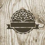 Organicznie produkt odznaka z drzewem na drewnianej teksturze Wektorowy Illust Zdjęcia Royalty Free