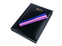 organisateur 2011 noir avec des crayons lecteurs Photographie stock libre de droits