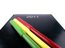 organisateur 2011 noir avec des crayons lecteurs Image libre de droits