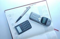 Organisateur, calculatrice, stylo-plume Images libres de droits