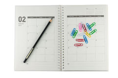 Organisateur de 2014 février avec le crayon et les agrafes. Photographie stock