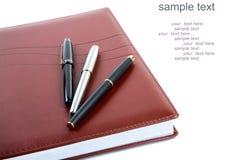 Organisateur en cuir un stylo-plume Photo stock