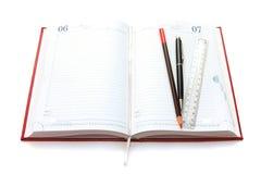 Organisateur, ligne et crayon lecteur rouges Photos libres de droits