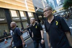 3 organisatoren van Occupy Centraal met Liefde en Vrede Royalty-vrije Stock Foto