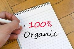 100% organisch concept op notitieboekje Stock Afbeeldingen