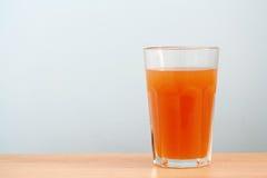 Organische Karotte Juice Background Lizenzfreie Stockfotografie