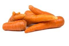 Organische Karotten lokalisiert auf weißem Hintergrund lizenzfreie stockbilder