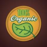 Organisches Gewebeabzeichen des Vektor 100% Stockfoto