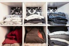 Organised wardrobe. The clothing storage hack using a bookshelf royalty free stock photo