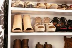 Organised wardrobe, the shoe storage. Hack using a bookshelf stock photography