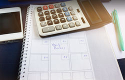 Organiser book with text yearly bonus and background of calcula stock photography