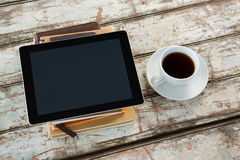 Organiser with digital tablet and coffee. On wooden table Stock Photography